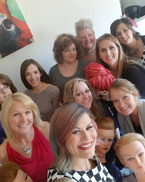 Kristan Sayers (front/center) with stylists from a recent class