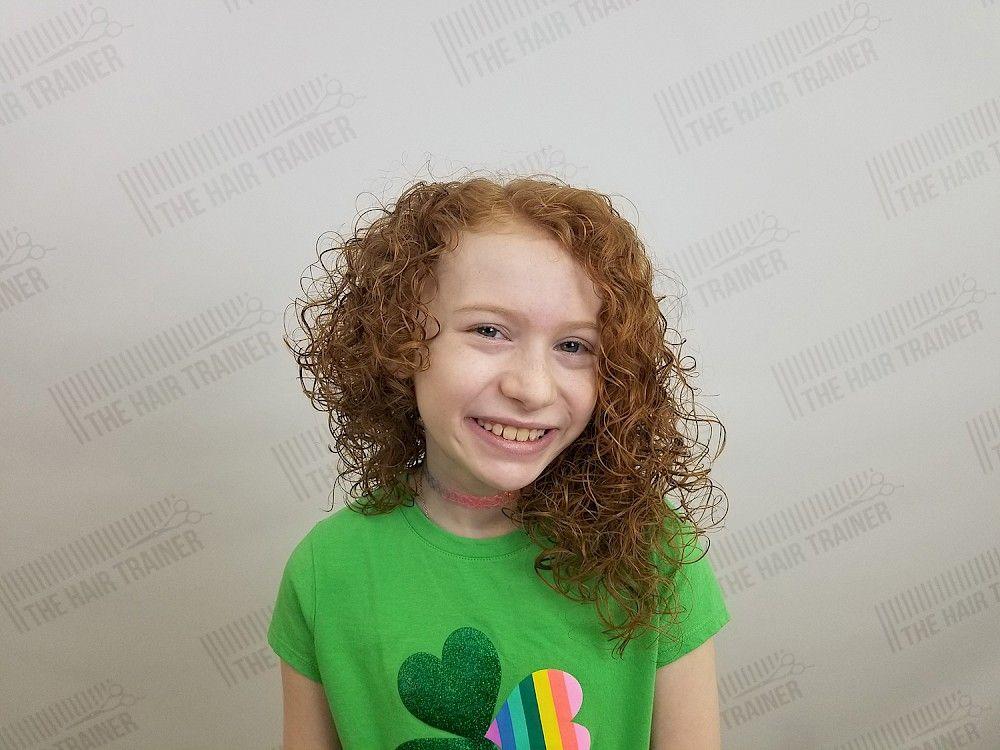 Asymmetric Curly Mid Length Haircut